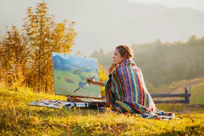 Lady artist painting outside